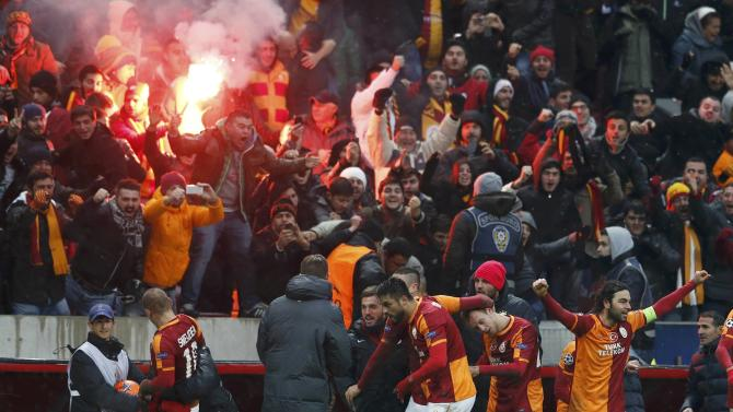 Team players of Galatasaray selebrate their goal against Juventus whch put them into the last-16.