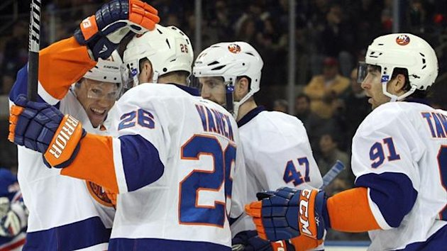 New York Islanders right wing Kyle Okposo (21) congratulates Islanders left wing Thomas Vanek (26) after he scored a goal against the New York Rangers (Reuters)