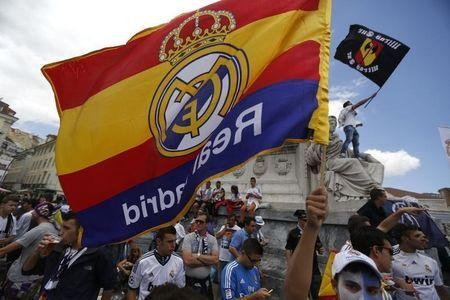 Real Madrid supporters wave their team's flags in downtown Lisbon