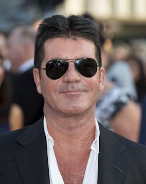 Simon Cowell attends the World Premiere of 'One Direction: This Is Us' at Empire Leicester Square on August 20, 2013 in London -- Getty Images
