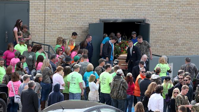 The body of Shain Gandee is carried from the Charleston Municipal Auditorium after funeral services Sunday, April 7, 2013 in Charleston, W.Va. Shain, 21, and David Dwight Gandee, 48, along with Donald Robert Myers, 27, were found dead in a vehicle near Sissonville, W.Va. last week. (AP Photo/The Daily Mail, Brad Davis)