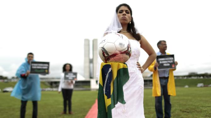 Members of NGO Rio de Paz protest in front of the National Congress in Brasilia