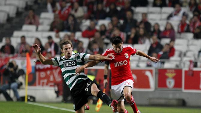 Benfica's Nico Gaitan, right, from Argentina battles for the ball with Sporting's Adrien Silva from France during a Portugal Cup soccer match between Benfica and Sporting at Benfica's Luz stadium in Lisbon, Saturday, Nov. 9, 2013