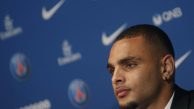 New Paris St Germain's player Kurzawa attends a news conference in Paris