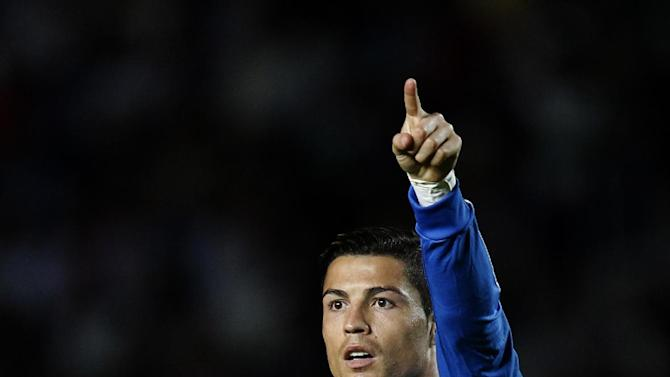 Real Madrid's Cristiano Ronaldo from Portugal points his finger during their La Liga soccer match against Elhe at the Martinez Valero stadium in Elche, Spain, Wednesday, Sept. 25, 2013