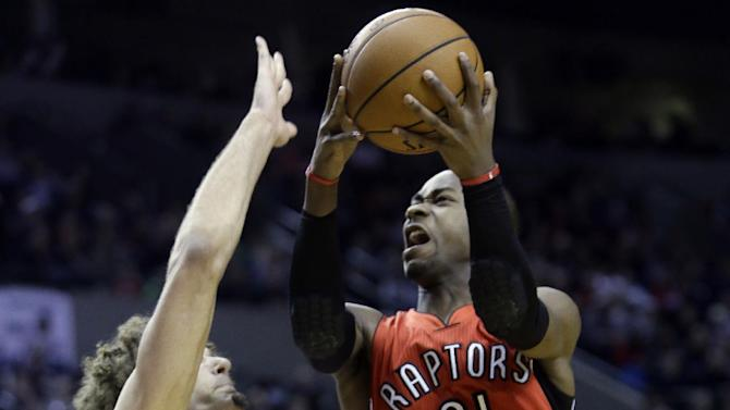 Toronto Raptors forward Terrence Ross, right, goes to the hoop against Portland Trail Blazers center Robin Lopez during the first half of an NBA basketball game in Portland, Ore., Saturday, Feb. 1, 2014