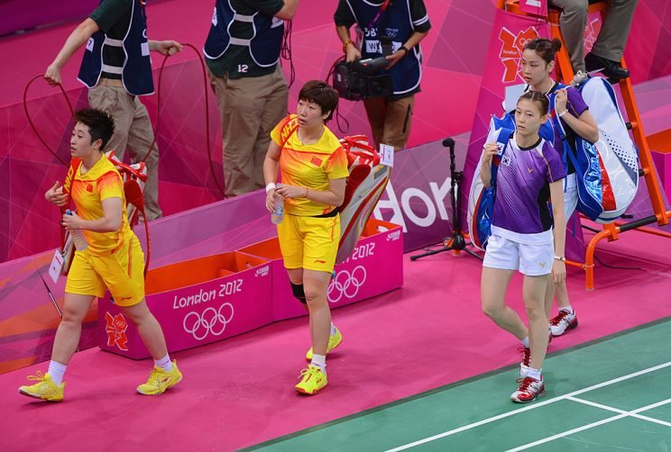 Wang Xiaoli and Yang Yu of China leave the court with Ha Na Kim and Kyung Eun Jung of Korea after their Women's Doubles Badminton on Day 4 of the London 2012 Olympic Games at Wembley Arena on July 31, 2012 in London, England. (Photo by Michael Regan/Getty Images)