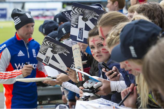 Fans wait their turn as England's Adam Lyth signs autographs before play on the first day of the second Test match between England and New Zealand at Headingley cricket ground in Leeds, England, F