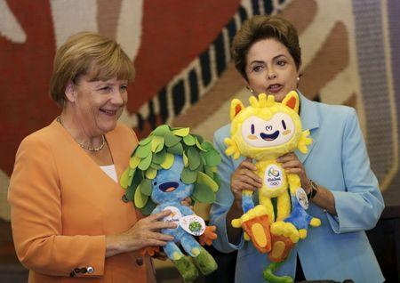German Chancellor Merkel receives Rio 2016 Olympic mascot Vinicius and Paralympic Games Tom from Brazil's President Rousseff before a lunch at the Itamaraty Palace in Brasilia, Brazil