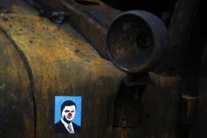 A sticker depicting Ukrainian President Viktor Yanukovych…