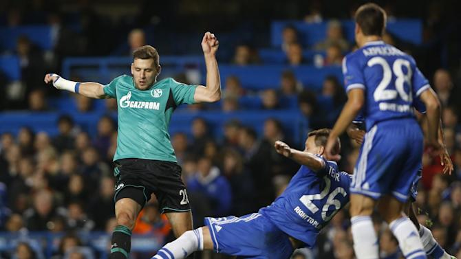 Schalke's Adam Szalai, left, challenges for the ball with Chelsea's John Terry during the Champions League group E soccer match between Chelsea and FC Schalke 04 at Stamford Bridge Stadium  in London Wednesday, Nov. 6, 2013
