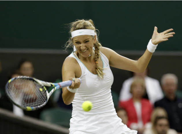 Victoria Azarenka of Belarus plays a return to Tamira Paszek of Austria during a quarterfinals match at the All England Lawn Tennis Championships at Wimbledon, England, Tuesday, July 3, 2012. (AP Phot