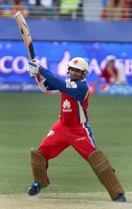 RCB player Parthiv Patel in action during the fifth match of IPL 2014 between Royal Challengers Bangalore and Mumbai Indians, played at Dubai International Cricket Stadium in Dubai of United Arab Emir