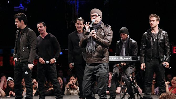 "FILE - In this Jan. 22, 2013 file photo provided by Starpix, New Kids on the Block members, from left, Jordan Knight, Danny Wood, Jonathan Knight, Donnie Wahlberg, and Joey McIntyre, far right, perform during the announcement of ""The Package Tour,"" in New York.   It's a crowded tour market and everyone is competing for your entertainment dollar. New Kids on the Block paired up with 98 Degrees and Boyz II Men for the aptly titled The Package Tour. (AP Photo/Starpix, Kristina Bumphrey, file)"