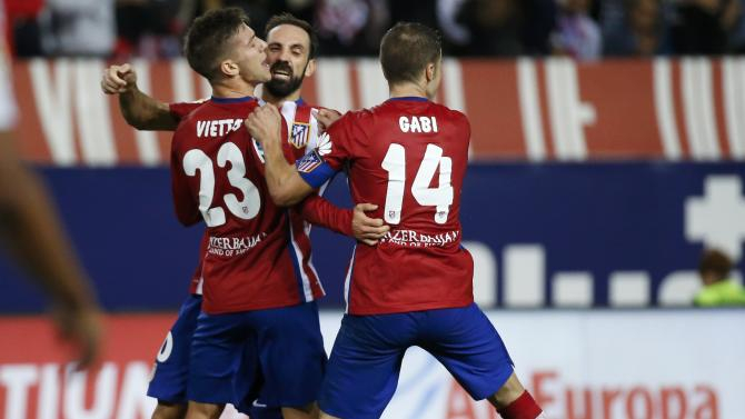 Atletico Madrid's Luciano Vietto celebrates after scoring a goal during their Spanish first division derby soccer match in Madrid