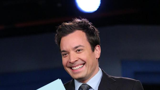 "This Feb. 18, 2013 photo released by NBC shows Jimmy Fallon, host of ""Late Night with Jimmy Fallon,"" on the set in New York. NBC announced Wednesday, April 3, 2013 that Jimmy Fallon is replacing Jay Leno as the host of ""The Tonight Show"" in spring 2014.  (AP Photo/NBC, Lloyd Bishop)"