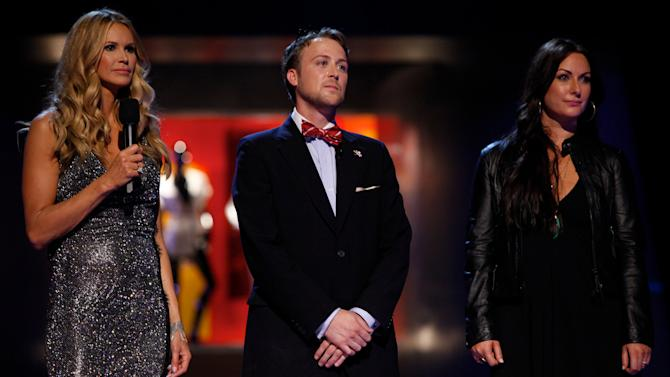 "In this undated image released by NBC, from left, host Elle Macpherson, Ross Bennett and Sarah Parrott are shown during the premiere episode of ""Fashion Star,"" airing Tuesday, March 13, 2012 at 9:30p.m. EST on NBC. ""Fashion Star,"" has 14 unknown designers who will compete to have their creations sold each week at  Saks Fifth Avenue, Macy's and H&M.  The winner will get $6 million in orders from all three combined.  (AP Photo/NBC, Tyler Golden)"