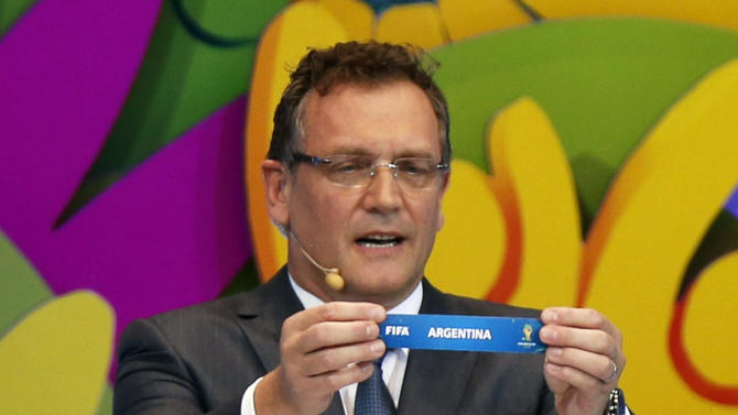 """FIFA Secretary General Jerome Valcke holds the slip showing """"Argentina"""" during the draw for the 2014 World Cup at the Costa do Sauipe resort in Sao Joao da Mata"""