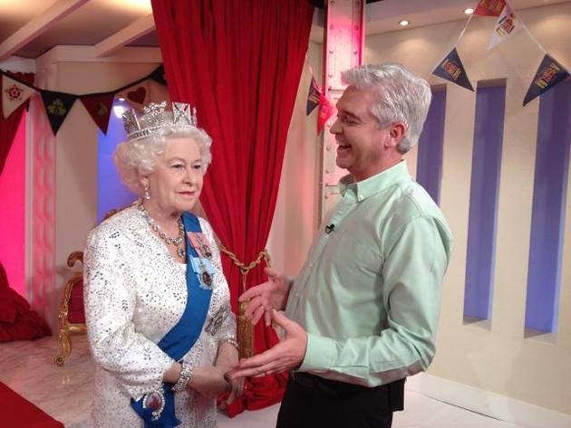 Celebrity photos: When a waxwork of the Queen arrived at the This Morning studios, Phillip Schofield couldn't resist the opportunity to pose for a funny Twitpic. Phillip posted this photo with the cap