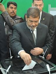Egyptian President Mohamed Morsi casts his vote at a polling station near the presidential palace in Cairo on December 15, 2012. Egypt's opposition has called for mass protests after Islamists backing President Mohamed Morsi claimed victory in the first round of a referendum it alleges was riddled with polling violations