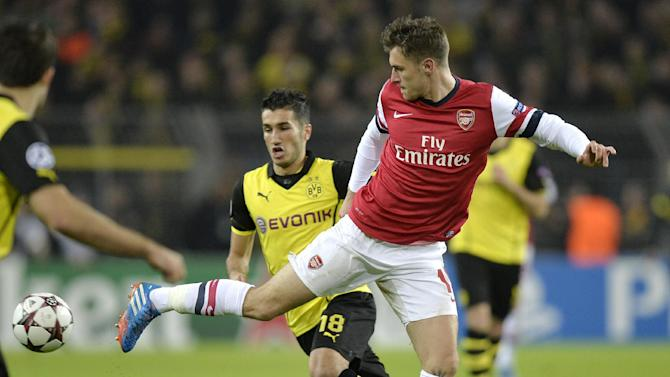 Dortmund's Nuri Sahin, left, and Arsenal's Aaron Ramsey challenge for the ball during the Champions League group F soccer match between Borussia Dortmund and Arsenal FC in Dortmund, Germany, Wednesday, Nov. 6, 2013