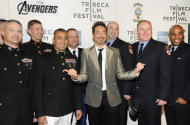 "Actor Robert Downey Jr., center, poses with members of the U.S. Military and New York Fire Department before the premiere of ""The Avengers"" during the 2012 Tribeca Film Festival on Saturday, April 28, 2012 in New York. (AP Photo/Evan Agostini)"