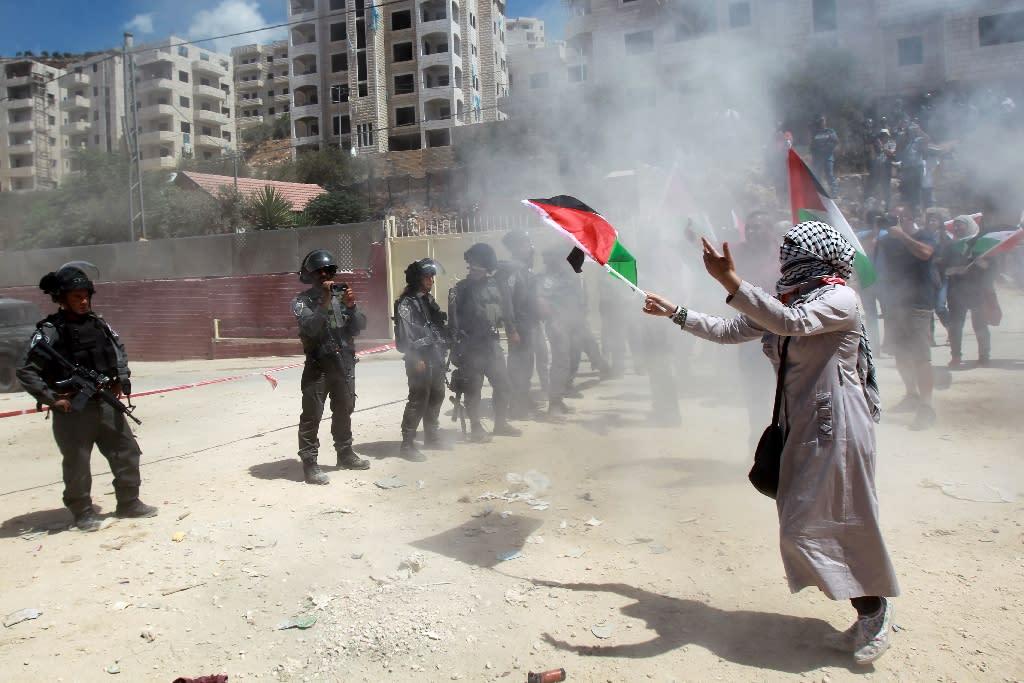 Israeli troops fire tear gas at separation barrier demo