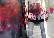 Men are reflected in a shop window of a lingerie store on the eve of St Valentine's Day in Frankfurt February 13, 2013. REUTERS/Lisi Niesner