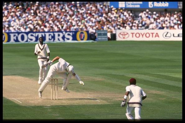 Aug 1991:  Ian Botham attempts to avoid a Curtly Ambrose bouncer but only succeeds in hitting his own wicket.  England v West Indies 5th Test at The Oval.                                     Mandatory