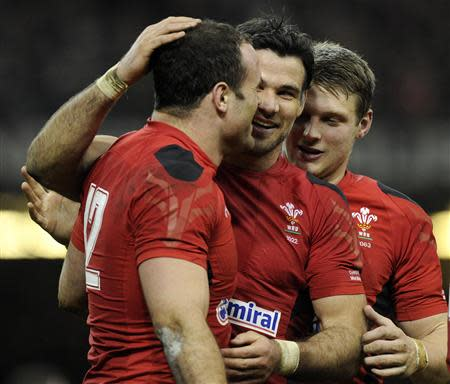 Wales' Mike Phillips congratulates Jamie Roberts on scoring a try against Scotland during their Six Nations Championship rugby union match at the Millennium Stadium, Cardiff,