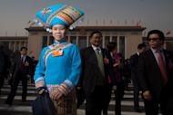Delegates leave the Great Hall of the People following the opening session of the National People's Congress (NPC) in Beijing on March 5, 2013. China targeted 2013 economic growth of 7.5 percent and vowed to tackle corruption and improve the quality of life as an annual parliamentary session to seal its transition to new leadership started