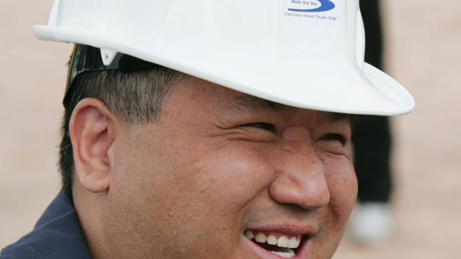 FILE- In this file photo taken March 7, 2007, David Jin is all smiles at the rollout for the Skywalk on the Hualapai Indian Reservation in Grand Canyon West, Ariz.  A representative says Jin the Chinese tour operator and Las Vegas businessman and who built the Grand Canyon Skywalk attraction in northwestern Arizona has died in Los Angeles. A Grand Canyon Skywalk Development spokesman said that Jin died Thursday June 13, 2013 at UCLA Medical Center after a four-year battle with cancer. He was 51. (AP Photo/Ross D. Franklin, File)