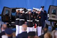 "US Marines salute during a ceremony marking the return to the US of the remains of the four Americans killed in an attack in Benghazi, Libya, at the Andrews Air Force Base in Maryland. President Barack Obama vowed Friday to ""stand fast"" against spreading anti-US violence raging in the Arab world, as he mourned the four slain Americans after their remains were flown home"