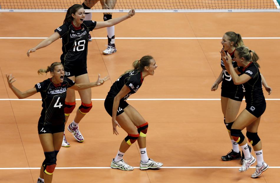 German players react during their FIVB Women's Volleyball World Grand Prix 2015 match against Belgium in Sao Paulo