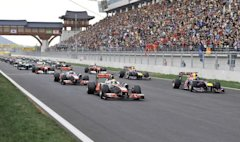 McLaren Formula One driver Lewis Hamilton of Britain leads Red Bull Formula One driver Sebastian Vettel of Germany and the pack off the grid the first