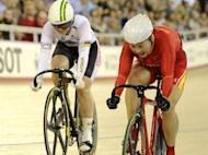 Australia's Anna Meares (L) and China's Guo Shuang compete during the women's sprint final at the UCI Track Cycling World Cup at the Velodrome in the Olympic Park in London