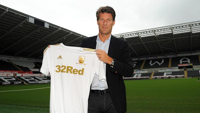 Michu is the third signing made by Michael Laudrup, pictured