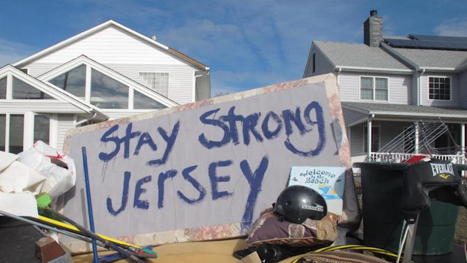 Residents of a flood-wrecked home in Point Pleasant Beach N.J. offer encouragement to fellow victims of Superstorm Sandy on Monday, Nov. 5, 2012, in this message scrawled on the bottom of a waterlogged mattress. A new storm, this one a nor'easter, was due to hit the shore Wednesday, raising fears of renewed damage and flooding. (AP Photo/Wayne Parry)