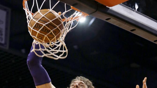 Los Angeles Lakers' Pau Gasol (16), of Spain, dunks as Phoenix Suns' Channing Frye (8) watches during the first half of an NBA basketball game Monday, Dec. 23, 2013, in Phoenix