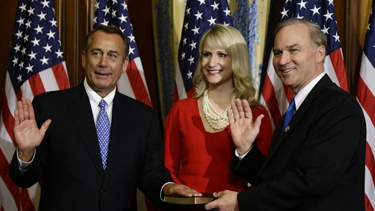 House Speaker John Boehner of Ohio performs a mock swearing in for Rep. Randy Forbes. R-Va., Thursday, Jan. 3, 2013, on Capitol Hill in Washington, as the 113th Congress began. (AP Photo/Charles Dharapak)
