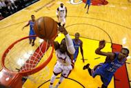 Miami Heat's Dwyane Wade dunks during the second half in the game against the Oklahoma City Thunder on June 17. The Heat, in the NBA Finals for the second year in a row, are trying to win their first NBA title since 2006