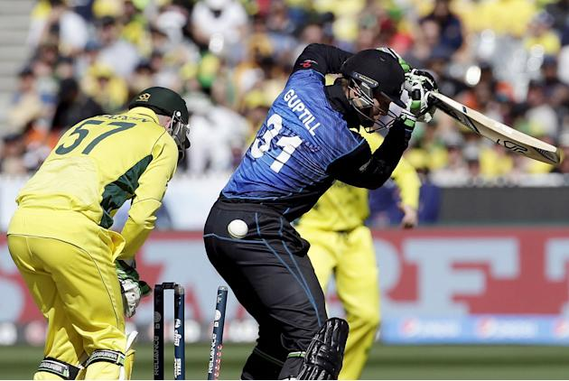 Australia's wicketkeeper Brad Haddin watches as New Zealand's Martin Guptill is bowled by Australia's Glenn Maxwell for 15 runs during their Cricket World Cup final match at the MCG