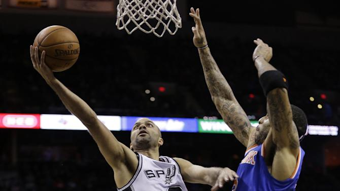 San Antonio Spurs' Tony Parker (9) shoots around New York Knicks' Kenyon Martin during the first half on an NBA basketball game, Thursday, Jan. 2, 2014, in San Antonio. (AP Photo/Eric Gay)
