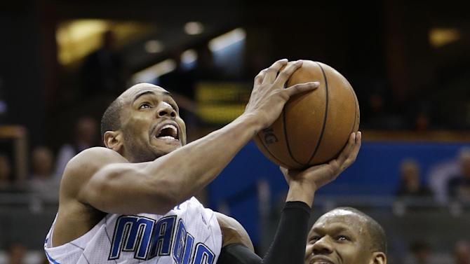 Orlando Magic's Arron Afflalo (4) makes a shot as he gets in front of Philadelphia 76ers' Lavoy Allen (50) during the second half of an NBA basketball game in Orlando, Fla., Wednesday, Nov. 27, 2013. Orlando won the game 105-94
