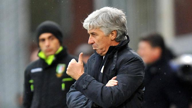 Genoa coach Gian Piero Gasperini gives the thumb-up sign during a Serie A soccer match between Genoa and Inter, at Genoa's Luigi Ferraris Stadium, Italy, Sunday, Jan. 19, 2014