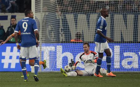 Schalke 04's goalkeeper Faehrmann sits on the ground after a goal by Real Madrid during their Champions League soccer match against Schalke 04 in Gelsenkirchen