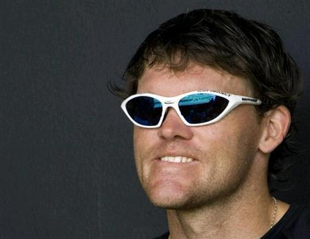 New Zealand's Lou Vincent smiles from the stand during a cricket match in Gros Islet March 22, 2007. REUTERS/Simon Baker/Files