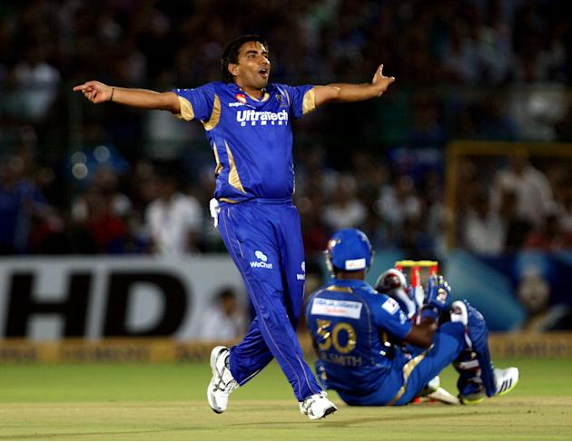 Rajasthan Royals bowler Vikramjeet Singh celebrate fall of Dwayne Smith's wicket  during the CLT20 match against Mumbai Indians at Sawai Mansingh Stadium, Jaipur on Sept. 21, 2013. (Photo: IANS)