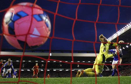 Oldham Athletic's goalkeeper Oxley fails to deflect teammate Tarkowski's own goal during their FA Cup third round soccer match against Liverpool at Anfield in Liverpool