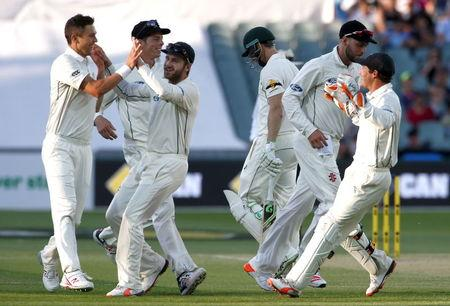Australia's Adam Voges walks off the ground after he was dismissed by New Zealand's Trent Boult for 28 runs during the third day of the third cricket test match at the Adelaide Oval, in South